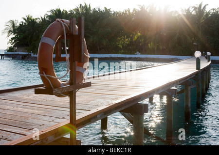 Pier on a small island in The Maldives - Stock Photo