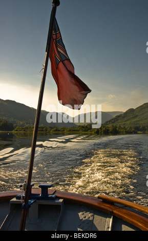 The lady of The Lake Ullswater steamer with a red flag flying on Ullswater, Lake District, Cumbria, England, UK - Stock Photo