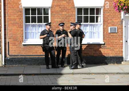 SWAT Police on duty wearing full body armor and carrying guns in Wootton Bassett Wiltshire - Stock Photo