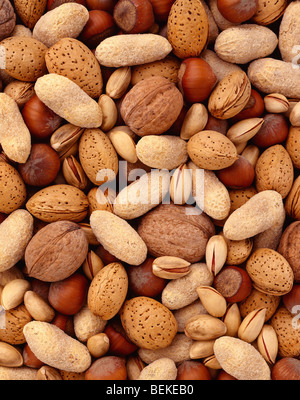 Hazelnuts, almonds, peanuts and walnuts as a background. - Stock Photo
