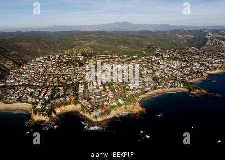 aerial view above residential ocean front property Crescent Bay and Emerald Bay north of Laguna Beach southern California - Stock Photo