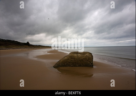 Omaha Beach, Normandy, France. Remains of WW2 D Day German blockhouse ruins on beach. - Stock Photo