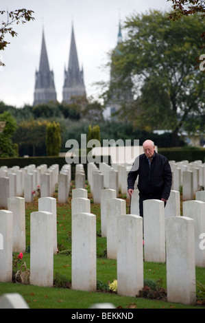 Bayeux Commonwealth War Graves Commission Cemetery,Bayeux,Normandy,France. Family member in picture, model released. - Stock Photo