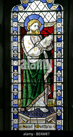 A stained glass window depicting St Matthew the Apostle, All Saints Church, Shipdham, Norfolk - Stock Photo