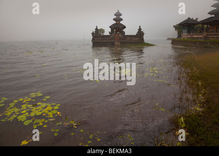 Pura Ulun Danu Bratan or Pura Bratan Temple, Candi Kuning, Bali, Indonesia, misty lake view - Stock Photo