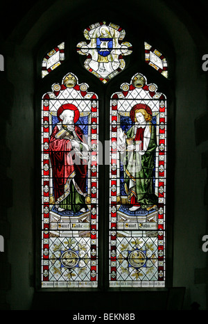 A stained glass window depicting Saints Luke and John, All Saints Church, Shipdham, Norfolk - Stock Photo