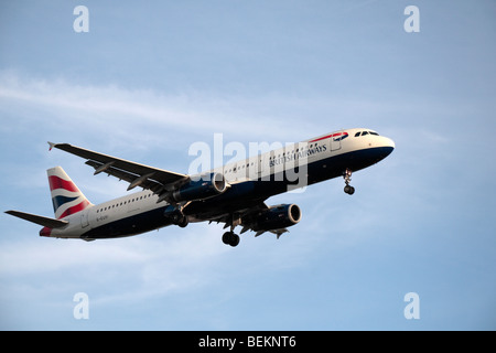 A British Airways (BA) Airbus A321-231 coming in to land at London Heathrow, UK.  August 2009. (G-EUXI) - Stock Photo