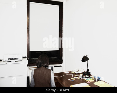 One Women Typing On Notebook Computer In Her Office - Stock Photo