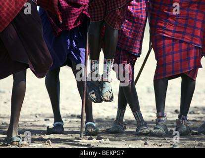 Masai man doing a traditional dance,  Amboseli National Park, Kenya, East Africa. - Stock Photo
