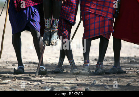 Masai men doing a traditional dance, Amboseli National Park, Kenya, East Africa. - Stock Photo