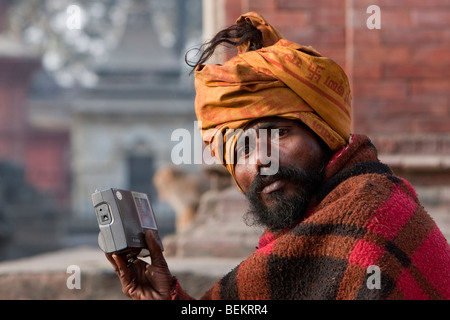 Pashupatinath, Nepal. Sadhu (Holy Man) and his Radio at Nepal's Holiest Hindu Temple. - Stock Photo
