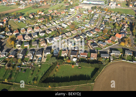 Urbanisation at the border of agricultural area from the air, Belgium - Stock Photo