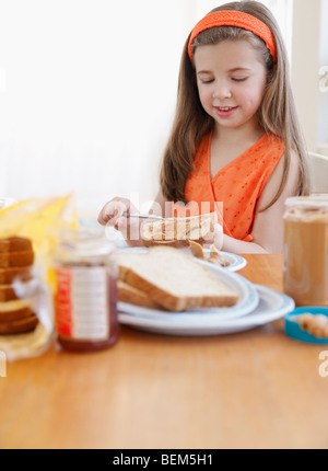 Child making lunch - Stock Photo