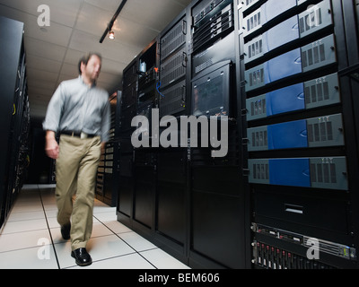 Man walking through data center - Stock Photo