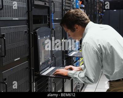 Man working in data center - Stock Photo