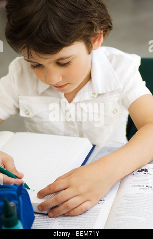 Elementary student working on assignment - Stock Photo