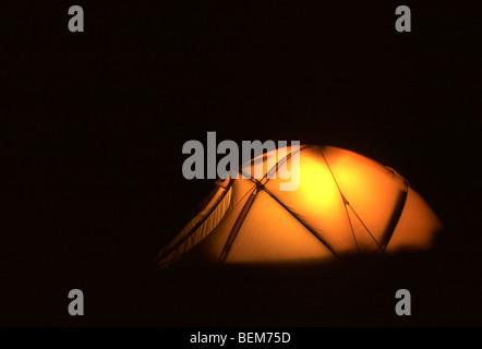 Illuminated tent in the tundra at night, Scandinavia - Stock Photo