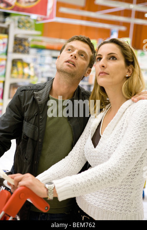 Couple in supermarket - Stock Photo