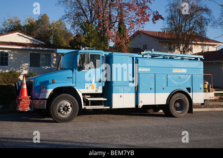 A PG&E utility truck powered by natural gas on a street. The truck is a clean air vehicle. Cupertino, California, - Stock Photo