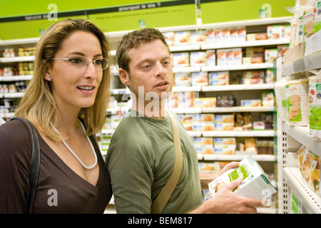 Couple shopping together at supermarket - Stock Photo