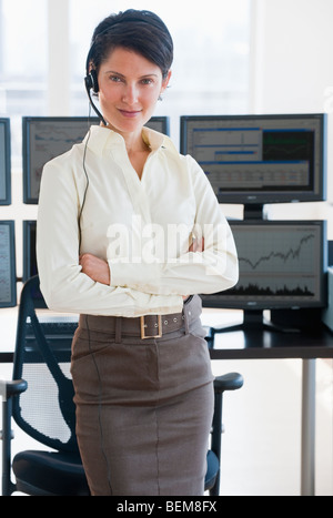 Female trader looking at camera - Stock Photo