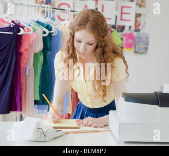 Woman doing paperwork - Stock Photo