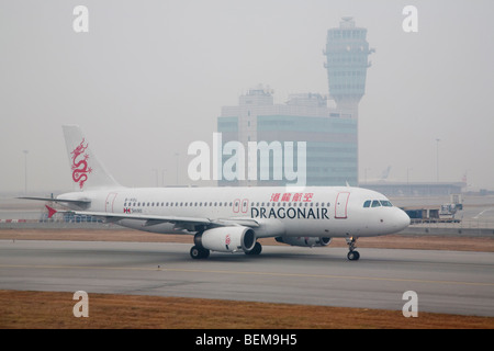 A DragonAir Airbus A320 airplane at runway. DragonAir is Hong Kong's domestic airline. Hong Kong, People's Republic - Stock Photo