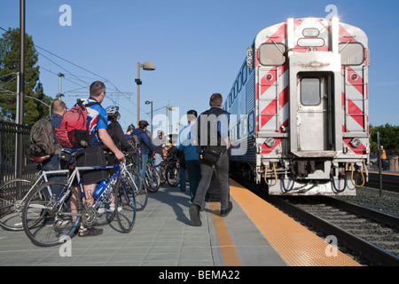 Bicyclists and commuters boarding a Caltrain train at the Downtown Mountain View station. Mountain View, California, - Stock Photo