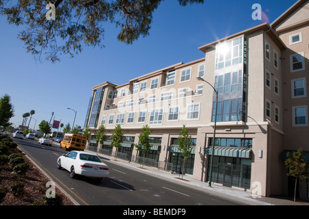 A tilted view of a building with condos and office space, viewed from a divided road. Park Broadway, El Camino Real, - Stock Photo