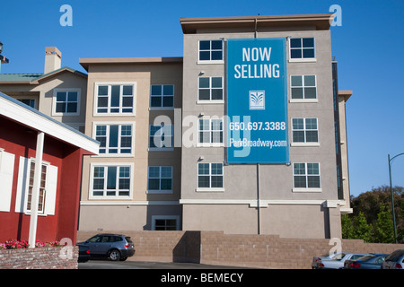 An advertising sign on a mixed used housing development. El Camino Real in Millbrae, CA, USA - Stock Photo