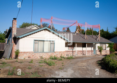 Small single family home ready for major construction project. It will be demolished and replaced. Silicon Valley, - Stock Photo