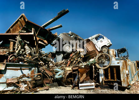 Dumping site with car wrecks and metal household waste for recycling iron and other metals - Stock Photo