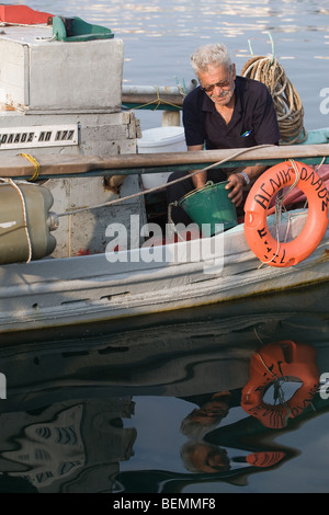 greek fisherman on a boat - Stock Photo