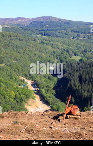 Conifer forest clearance with excavator and road improvements on the A470, Snowdonia National Park, North Wales - Stock Photo