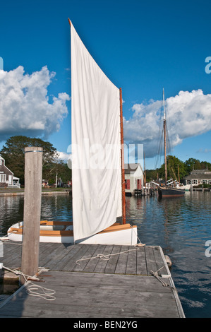 Connecticut Mystic Seaport small historic wooden sailboat at dock - Stock Photo