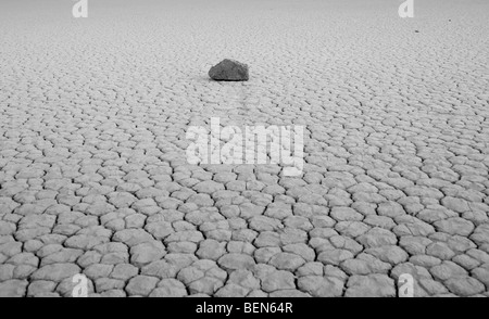 Cracked mud flats of the Playa in Death Valley National Park - Stock Photo