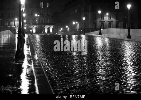 Rainy Night street scene in Paris - Stock Photo