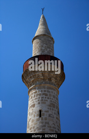 minaret of the small 11th century touzla mosque in larnaca republic of cyprus - Stock Photo