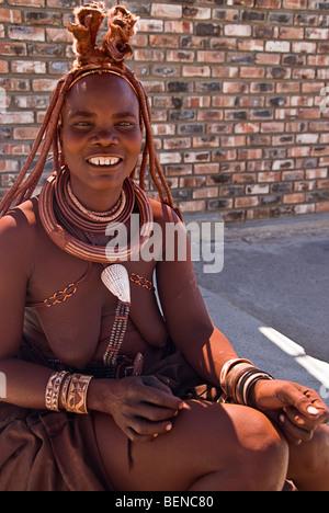 Himba woman in a village near Epupa Falls, Namibia, Africa. - Stock Photo