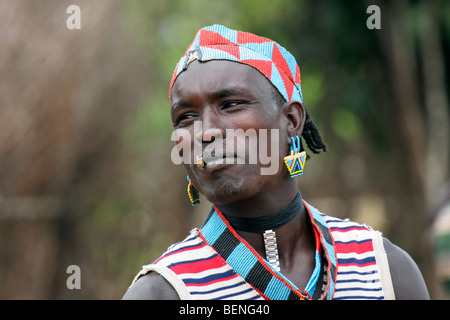 Man of the Bana / Bena tribe in traditional dress wearing colourful beads in Key Afar, Ethiopia, South Africa - Stock Photo