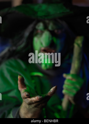 Scary old witch with outstretched hand - Stock Photo