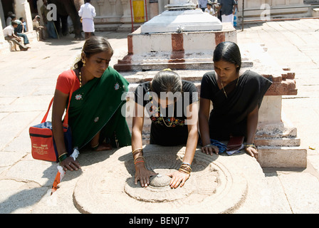 Women at Virupaksha Temple also called Pampapathi temple is located at the foot of Hemakuta Hill and was rebuilt - Stock Photo