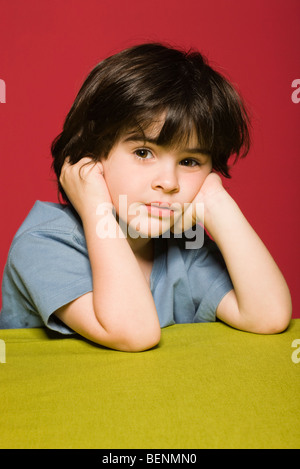 Little boy daydreaming, portrait - Stock Photo