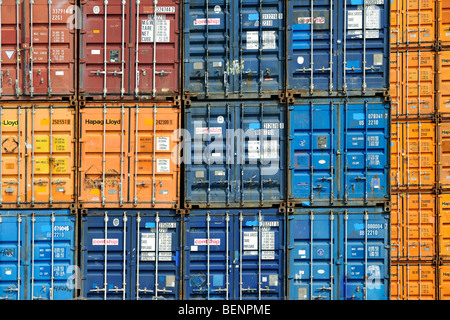 Piled up / Stacked up shipping containers at container terminal in port - Stock Photo