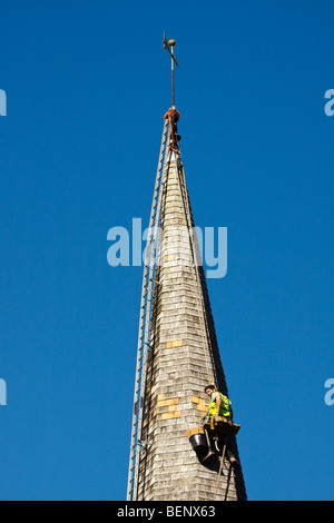 Steeplejack working on the church roof at Horsted Keynes - Stock Photo