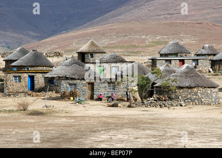 Basotho / Basuto village showing stone huts with thatched roofs in Lesotho, Africa - Stock Photo