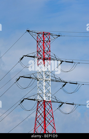 High-voltage pylon / transmission tower / electricity pylon in red and white - Stock Photo