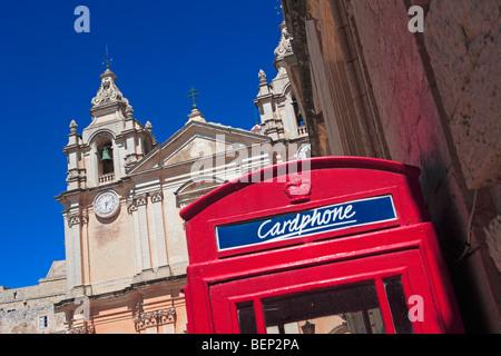 Cardphone British telephone box and St Paul's Cathedral, Mdina, Malta - Stock Photo