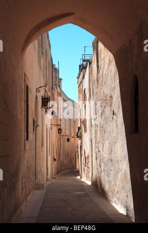 Typical narrow street in Mdina, Malta - Stock Photo