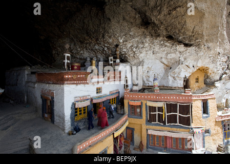 Buddhist monks entering into the sacred temple in the cave. Phugtal monastery. Zanskar. India - Stock Photo